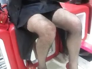 Girl in stockings changing her shoes in a shoe shop