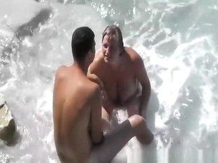 Busty nudist water blowjob