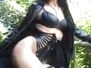 Slut in latex, poses on the street