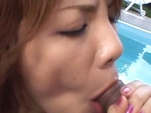 Sara Nakumara gives head to two cocks outdoors