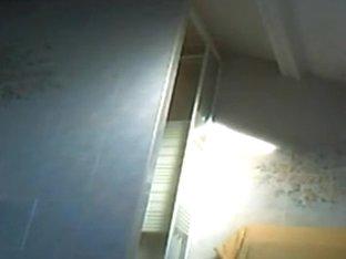 Voyeur tapes a brunette naked in the bathroom