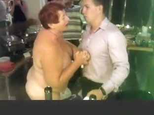 Elderly woman doing a striptease