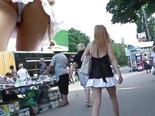 Blond bimbo flashes panty upskirt