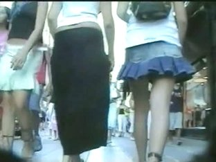 Upskirt voyeur follows a cute blonde with a perky butt