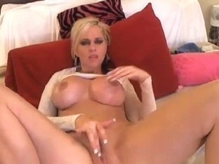 Busty Blonde Plays with Sex Toy