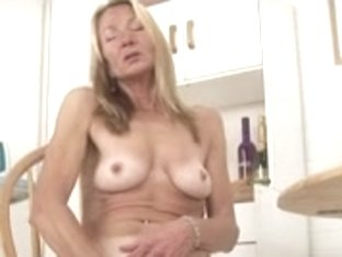 Blonde mature fucks herself with a banana
