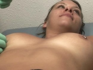 hot brunette college girl getting her nipples pierced