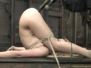 Samantha Sin - blond, shaved, toned, and a former gymnast - now a first time bondage model.
