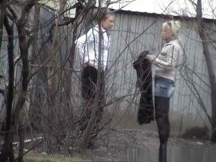Girls pissing behind bush