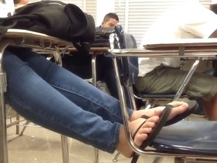Candid feet flip flops on chair 2