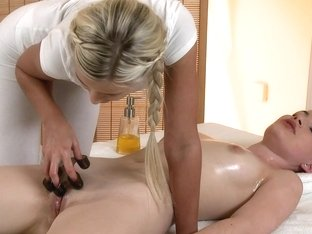 Blonde does a sensual massage to her lesbian girlfriend