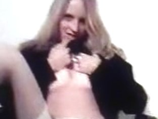 Chubby young blonde spreading her legs to show her shaved pussy