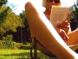 French babe masturbating her slit in the backyard
