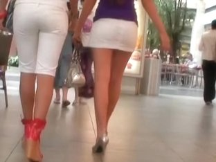 Two absolutely stunning babes show their round asses