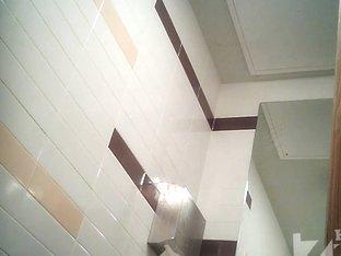 Blonde girl pissing in toilet on the hidden camera