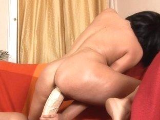 Romana has joy riding a large white brutal sex-toy