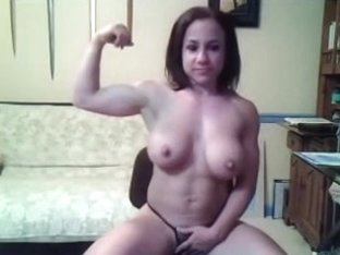 Busty body builder rubs her pussy in front of the camera