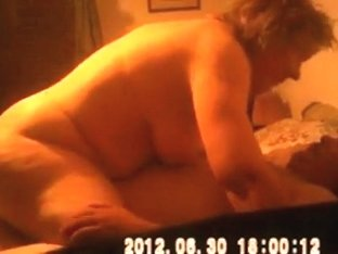 Busty mature fat woman sucks and rides her husband on the bed