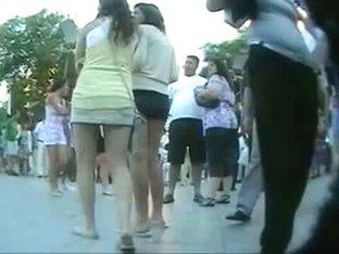 Couple of smokin brunettes in an upskirt public square ass video