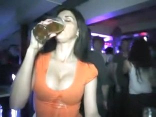 She drinks and it drips into her cleavage