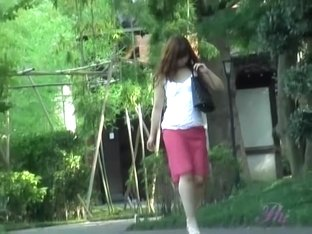 Stylish oriental hottie loses her sexy skirt when someone grabs it