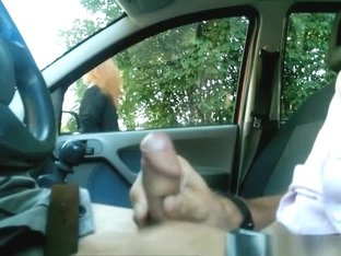 Guy plays with his cock inside car