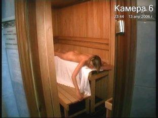 Naked blonde voyeur in sauna