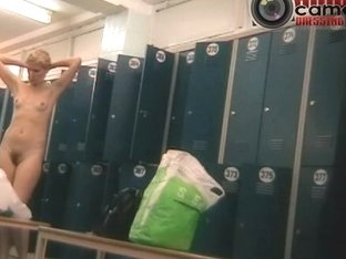 Hot MILF considering her charms in the women's locker room
