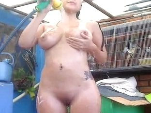 Outdoor showering of Latina babe on selfshot camera