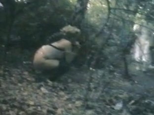Voyeur catches a naughty girl pissing in the woods
