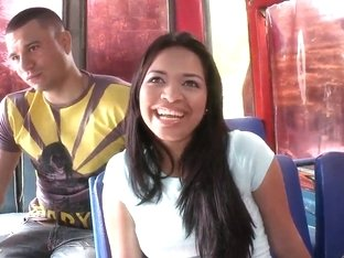 Young and radiant Latina Dayana with beautiful smile in the public transport