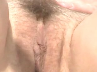 Hairy pussy shot on a nudist beach in close up