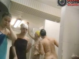 Several tall swimmers being nude in a voyeur bath cam video