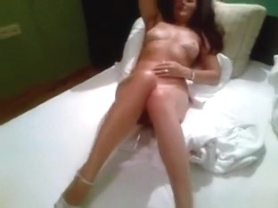 Brunette milf teases her husband naked on the bed
