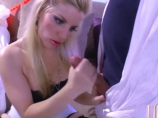 Blonde babe Ashley gets a dick she likes to chew on and jerks it off