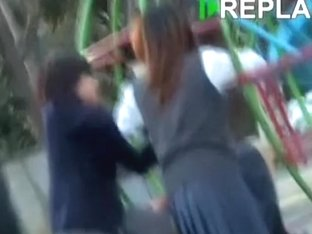 Two schoolgirls in the park getting skirt sharked by one guy