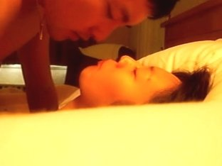 Homemade sex video of an Asian couple in the bedroom