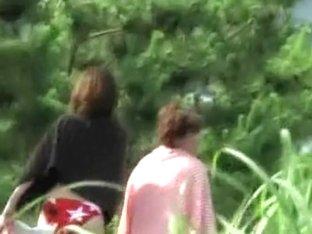 Asian milf and teen babe got bikini sharked after sunbathing
