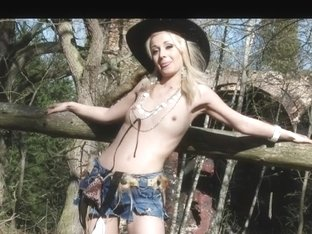 Blonde cowgirl in the woods