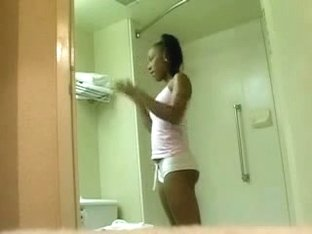 Ebony babe barenaked in the bathroom
