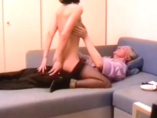 Young girl rides an old man on the sofa