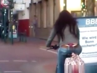 Red thong woman riding bike