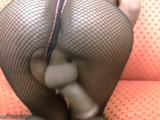 Ample ebony shemale in overall fishnet gives handjob