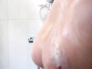 Angel White is taking a hot shower and masturbating
