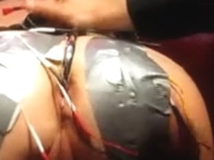 Leather porn video in which a latex bitch sucks a rod