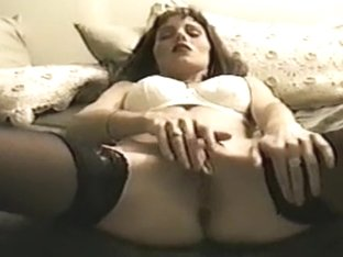 slender wife rubs and fingers her sexy twat.