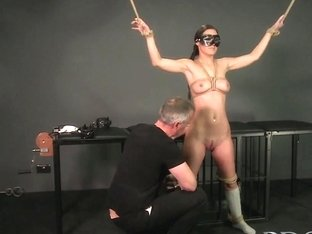 Bondage Master brings his cute asian sub girl to a long intense orgasm