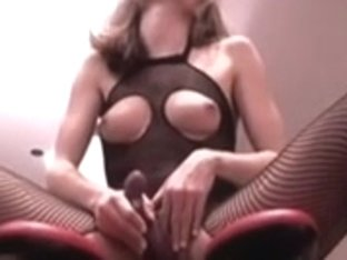 Sexy wench riding vibrator rocking chair in fishnet bodysuit