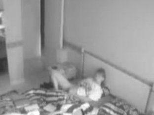 Hotel spy cam footage of a sexy woman masturbating