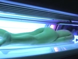 Consummate busty dark brown hair chick in the solarium bare on hidden camera